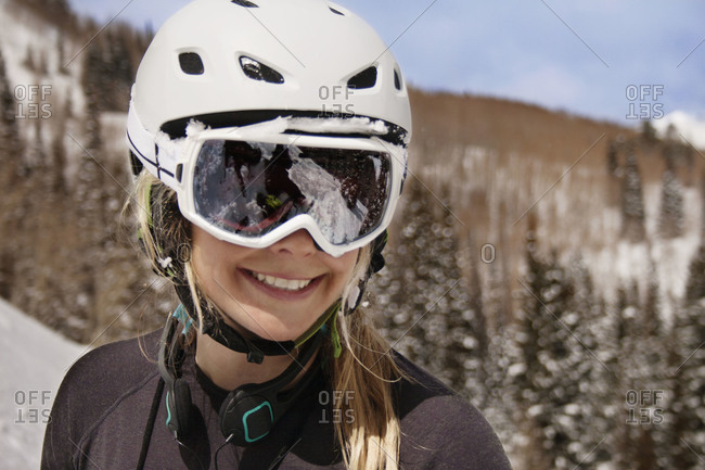 A young woman smiling in ski gear