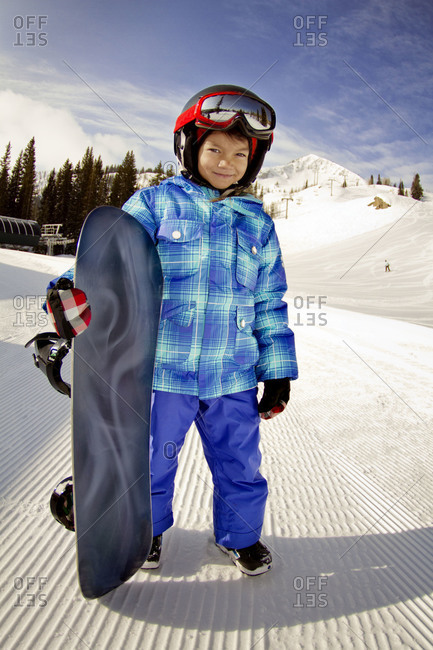 A young girl with a snowboard