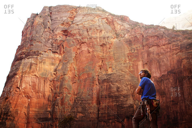 A mountain climber surveys the landscape