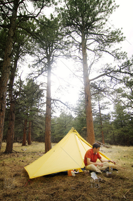 A man camping in the woods