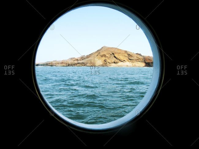 View of Galapagos Islands through a porthole