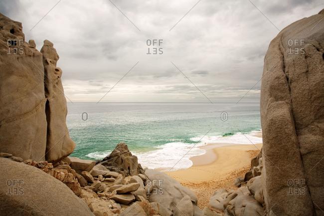View of the ocean through cliffs