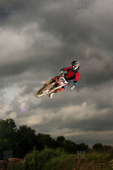 Motocross rider doing a stunt with his bike