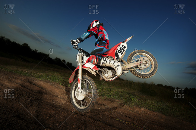 Motocross rider performing a stunt with his bike