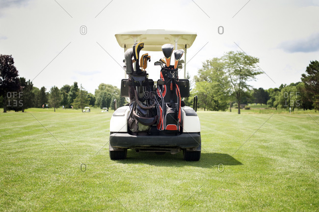 Golf cart from behind in a golf course