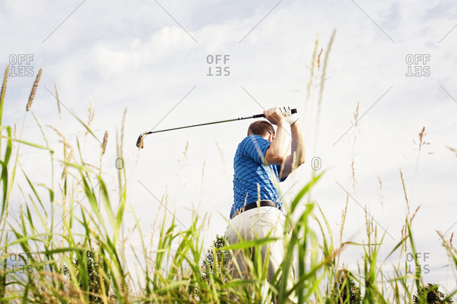 Low angle view of man playing golf