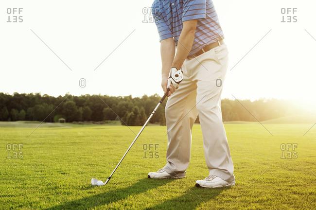 Golfer lining up a shot