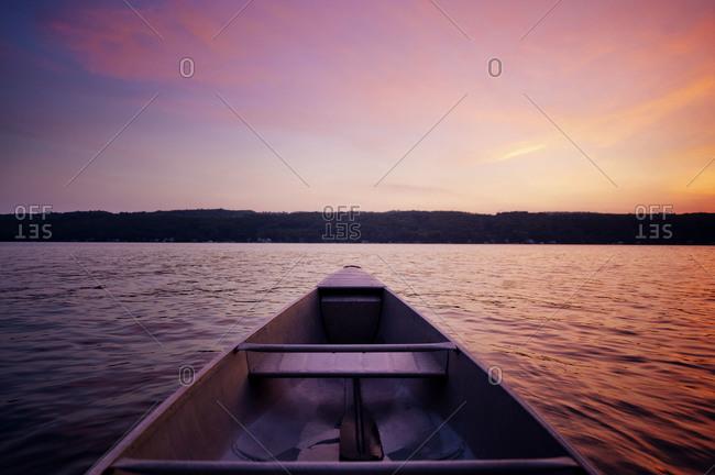 Canoe on a lake at sunset