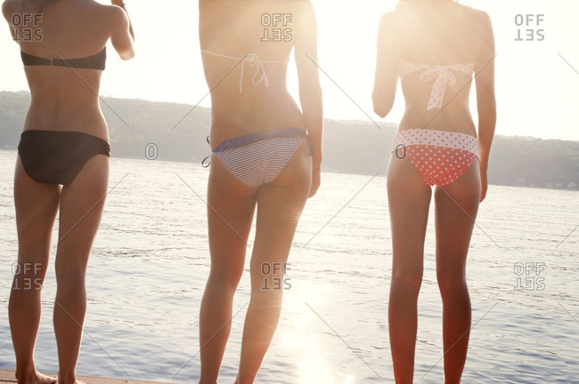 Back view of young women at a lake