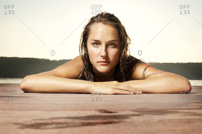 Young woman resting on jetty