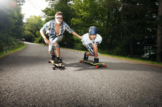 Teenagers riding skateboards