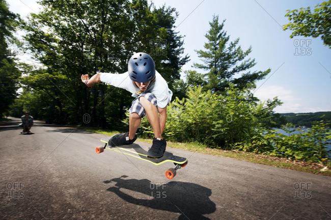 Boy doing a skateboarding trick