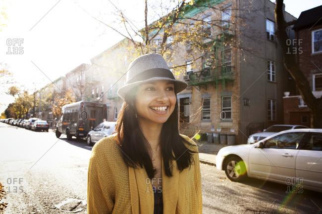 Young woman walking down an urban street