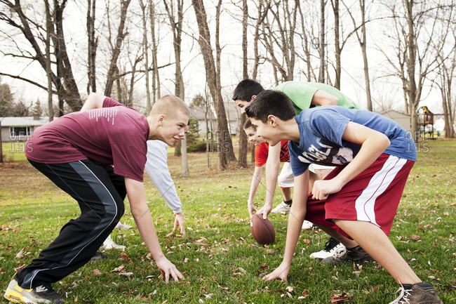 Boys playing football in the backyard
