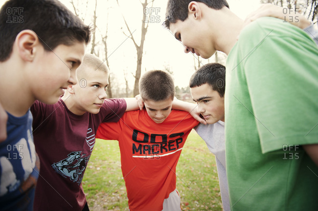 Teenagers in a huddle in the backyard