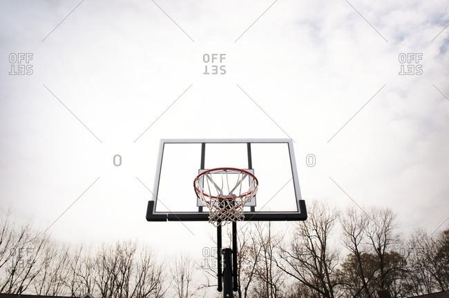 Basketball hoop against a cloudy sky