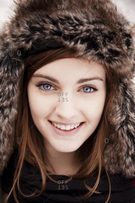Portrait of girl wearing a furry hat