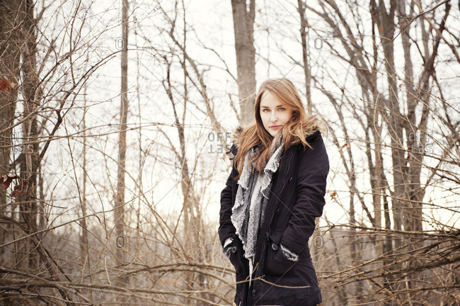 Portrait of young woman in a winter forest