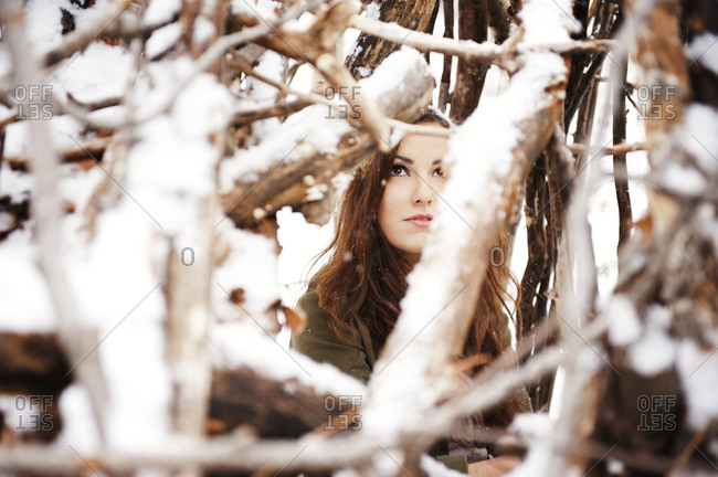 Woman amongst snow-covered branches