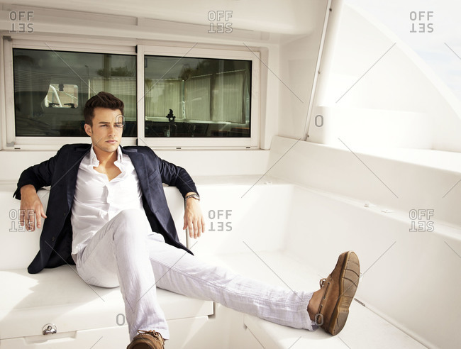 Portrait of young man relaxing on a sailboat