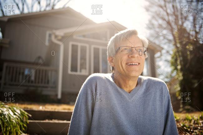 Portrait of elderly man smiling outdoors