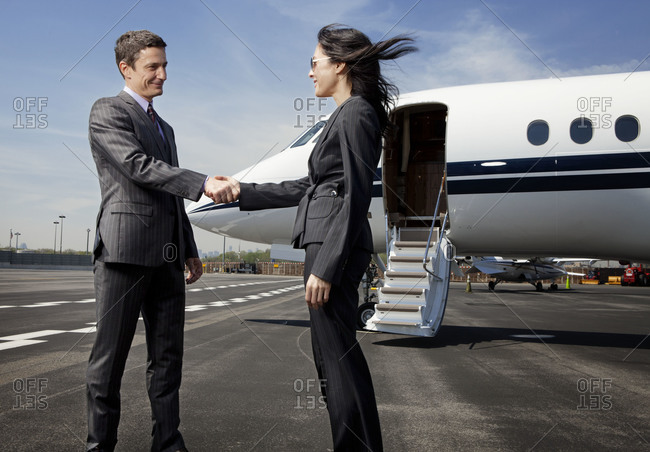 Woman greeting a businessman at the airport