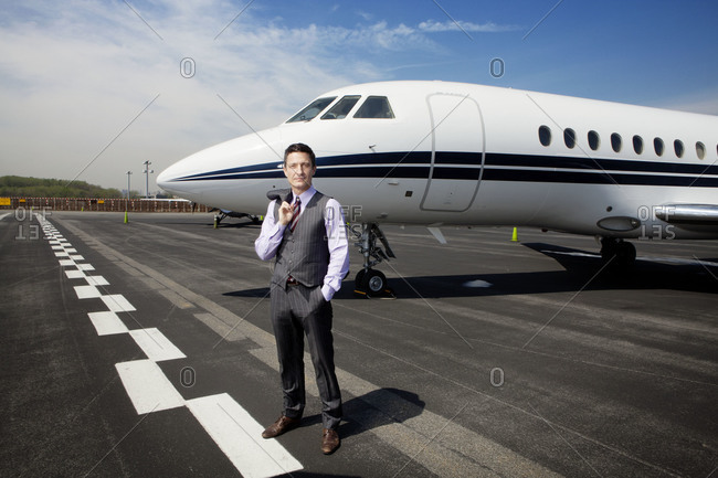 Businessman posing at an airport