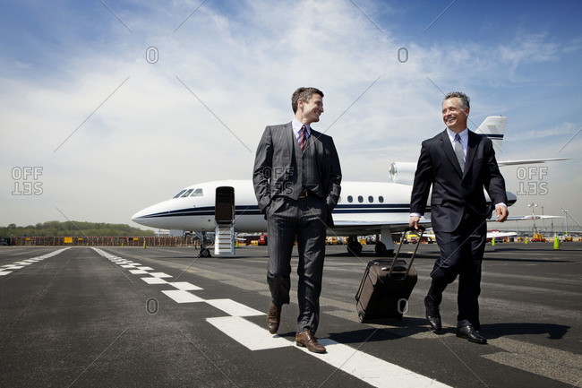Businessmen walking at the airport