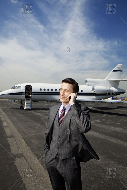 Businessman talking on the phone at the airport