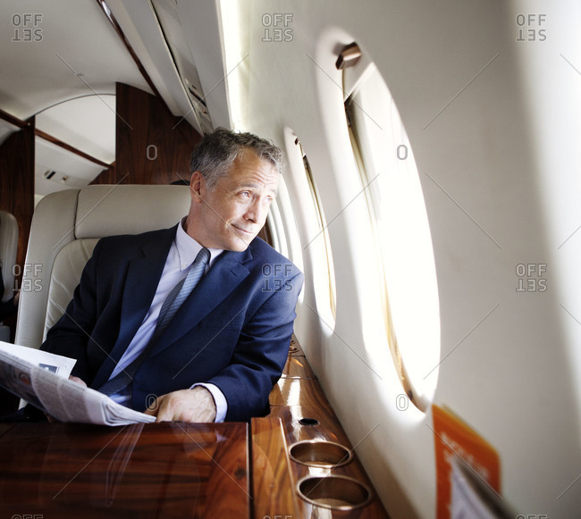 Businessman traveling on a private jet