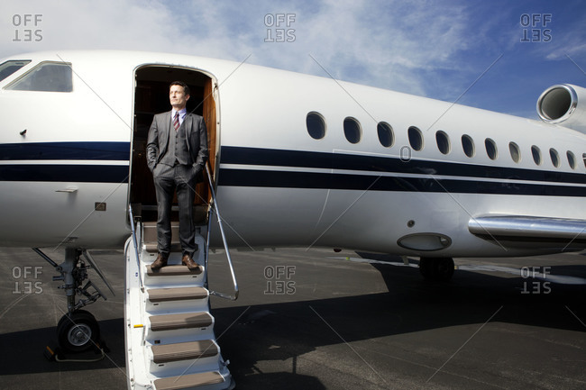Businessman standing on the airstairs