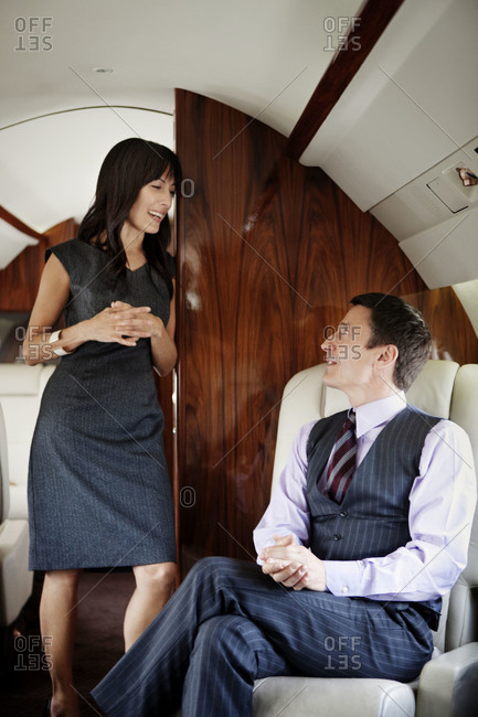 Business people talking on a private jet