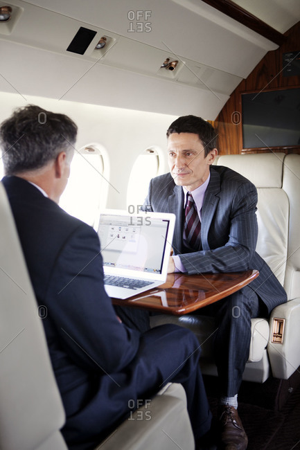 Businessmen working on a private jet