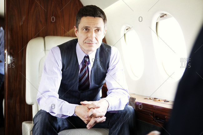 Portrait of a businessman a private jet
