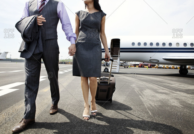 Couple walking at the airport
