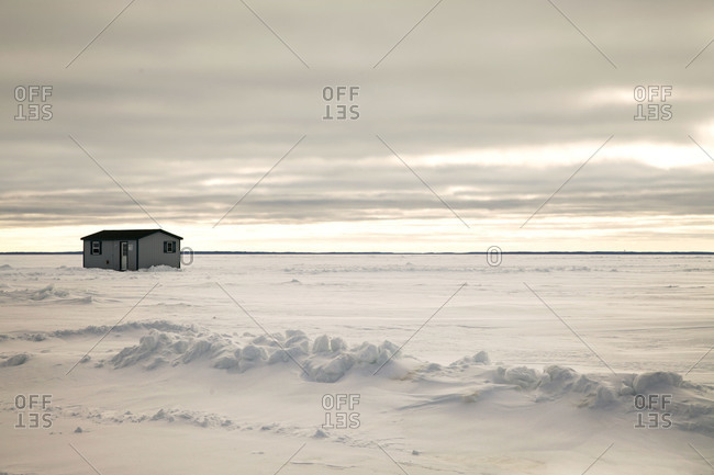 House in a snow-covered field in rural Alaska
