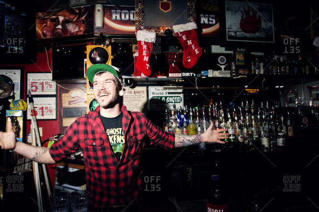 Portrait of a bartender in a pub