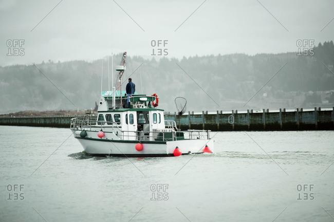 Fishing boat sailing in a bay
