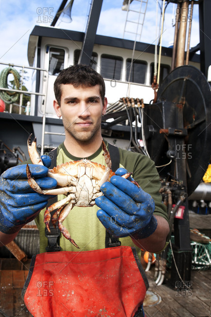 Fisherman holding a crab