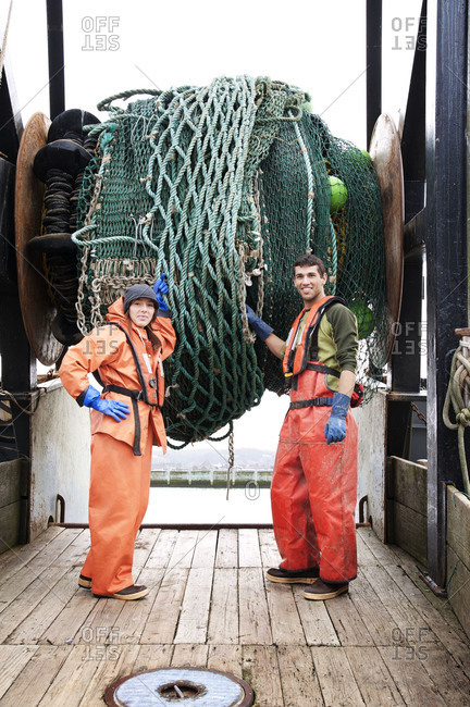Workers standing on a fishing boat