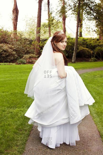 Bride walking on a path