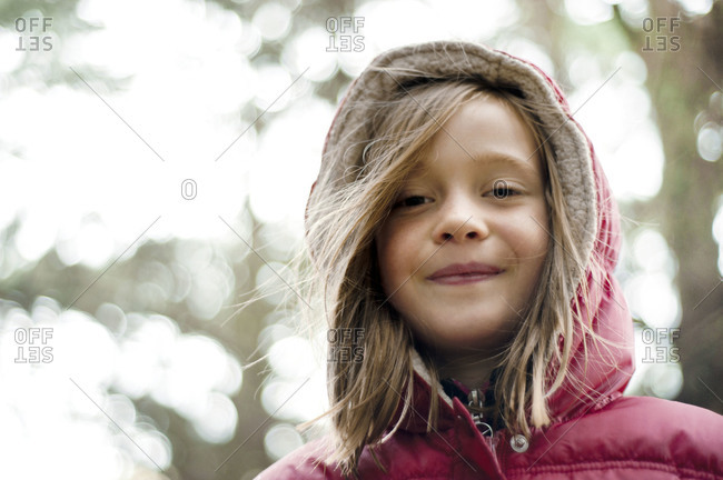 Portrait of a girl in a hooded coat