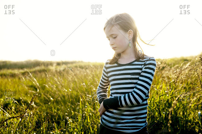 Girl standing on a meadow