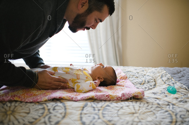 A father interacts with his infant child