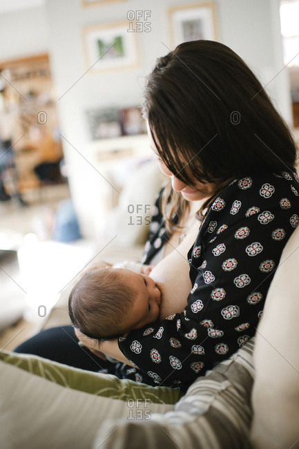 A mother nurses her newborn
