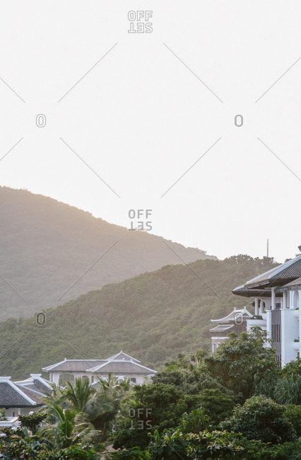Rooftops in lush mountain setting