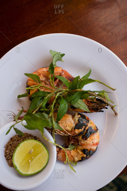 Whole cooked prawns on plate in restaurant