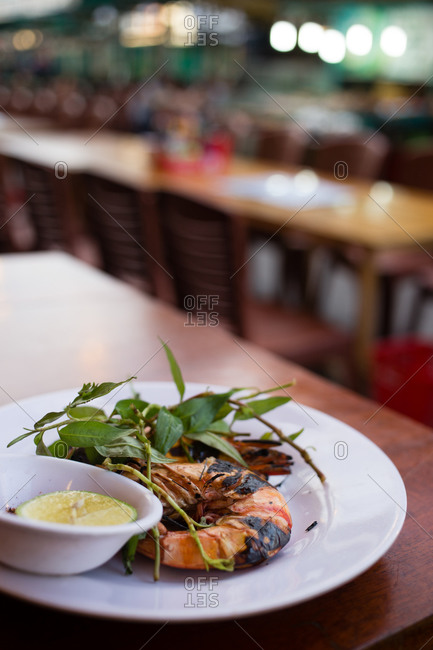 Whole roasted prawns on plate in restaurant
