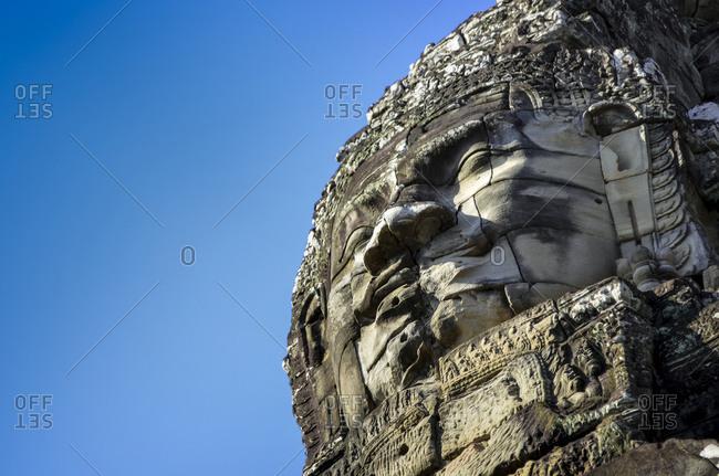 Angkor, Cambodia - December 6, 2012: Face at Bayon Temple, Angkor Wat