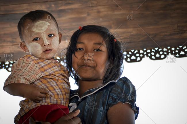 Bagan, Burma - January 16, 2014: Portrait of children from Began
